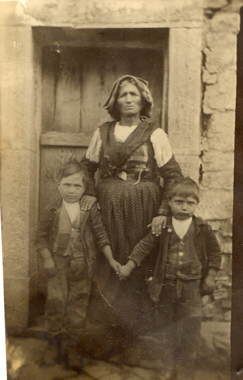 Maria Grazia Taggio – our great grandmother, Great Uncle Leonardo Antonio on the left and Grandpa Ruggiero on the right, standing in front of the family farm.
